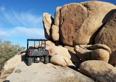 10a Polaris Ranger parked on rock